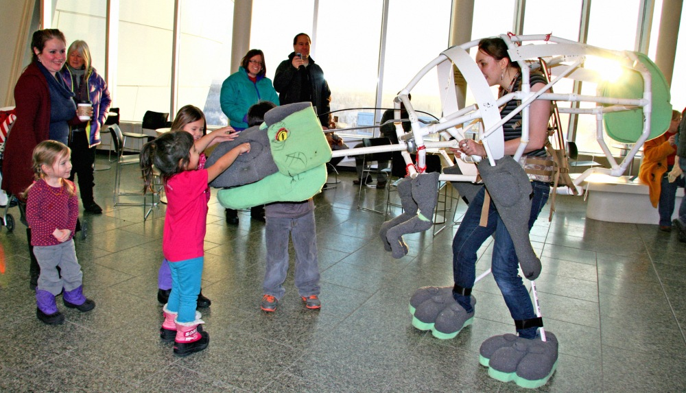 Animator Hannah Foss introduces Snaps, the animatronic dinosaur, to the community at the museum's Open House in January 2015.