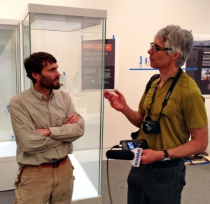 Earth sciences curator Pat Druckenmiller talks to a reporter about the museum's new exhibit.